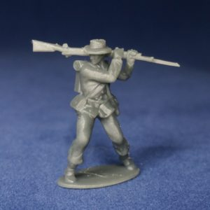 Confederate in sack coat & hat swings musket from shoulder