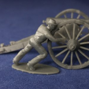 Confederate canoneer in kepi moving cannon for right wheel